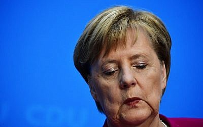 German Chancellor and leader of the Christian Democratic Union (CDU) Angela Merkel closes her eyes during a press conference at the CDU headquarters on October 29, 2018 in Berlin. Merkel announced she will not stand again as leader of her centre-right CDU, which she has chaired the CDU for 18 years, and will step down as German chancellor when her mandate ends in 2021. (Tobias SCHWARZ / AFP)