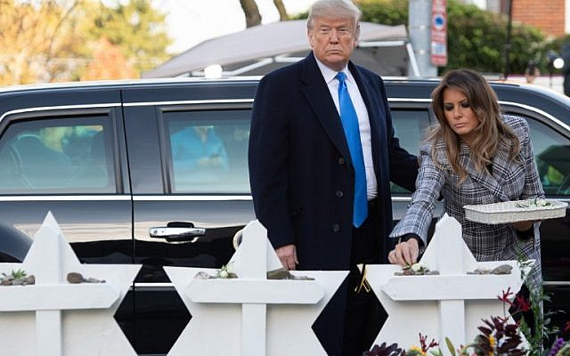 US President Donald Trump and First Lady Melania Trump place stones and flowers on a memorial as they pay their respects at the Tree of Life Synagogue following last weekend's shooting in Pittsburgh, Pennsylvania, October 30, 2018(Photo by SAUL LOEB / AFP)