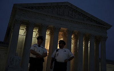 Police officers stand guard in front of the US Supreme Court October 5, 2018 in Washington, DC. (Alex Wong/Getty Images/AFP)