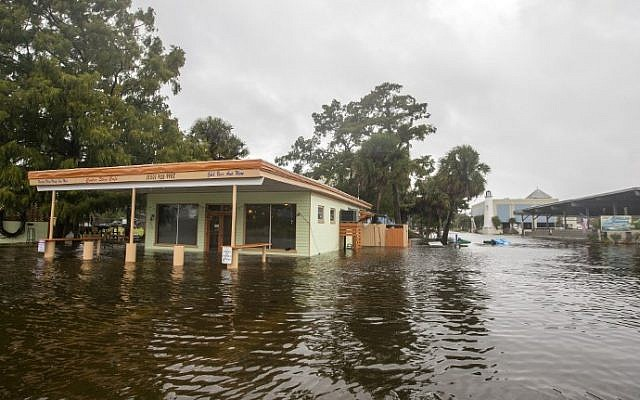 The Cooter Stew Cafe starts taking water in the town of Saint Marks as Hurricane Michael pushes the storm surge up the Wakulla and Saint Marks Rivers which come together here on October 10, 2018 in Saint Marks, Florida. The hurricane is forecast to hit the Florida Panhandle at a possible category 4 storm.   (Mark Wallheiser/Getty Images/AFP)