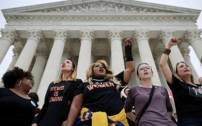 Protesters gather on the steps of the US Supreme Court after over running police barricades while demonstrating the confirmation of Associate Justice Brett Kavanaugh October 6, 2018 in Washington, DC. (Chip Somodevilla/Getty Images/AFP)