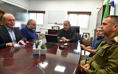 From L to R: National Security Adviser Meir Ben-Shabbat, Prime Minister Benjamin Netanyahu, Defense Minister Avigdor Liberman,  Shin Bet chief Nadav Argaman and IDF Deputy Chief of Staff Aviv Kochavi hold a situaltina assessment near the Gaza border on October 17, 2018. (Ariel Hermoni/Ministry of Defense)