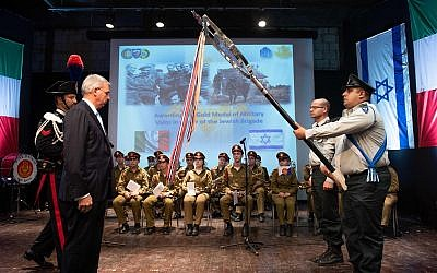 The Italian Ambassador to Israel, Gianluigi Benedetti, presents the Gold Medal for Military Valor to the IDF's 7th Armored Brigade on October 3, 2018. (Israel Defense Forces)