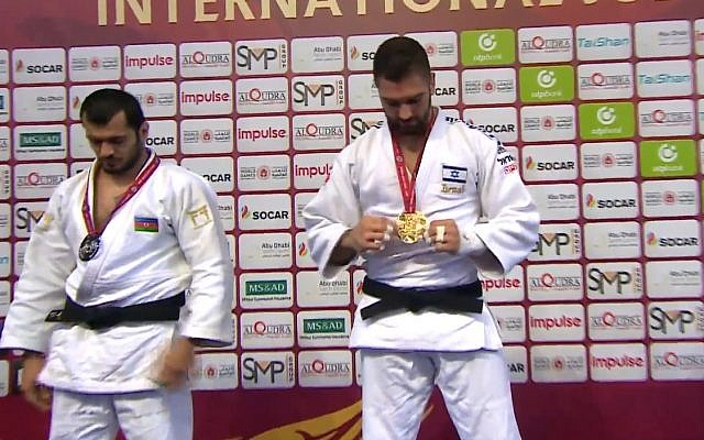 Screen capture from video of Israeli judoka Peter Paltchik, right, who taking a gold medal in the under 100 kilogram category at the International Judo Federation Grand Prix in Abu Dhabi, October 29, 2018. (International Judo Federation)