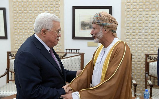 Palestinian Authority President Mahmoud Abbas and Omani Foreign Minister Yusuf bin Alawi shaking hands in Ramallah on October 31, 2018. (Credit: Wafa)
