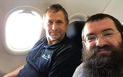 Rabbi Zalmen Wishedski, right, wrote a Facebook post about his conversation with a German man who travels to Israel to renovate Holocaust survivors' apartments. (Wishedski/JTA)