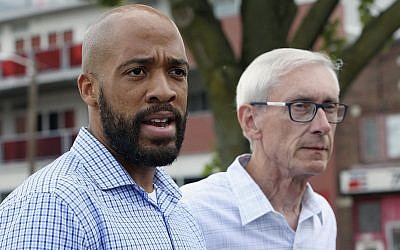 In this photo from August 15, 2018, Wisconsin Democratic lieutenant governor candidate Mandela Barnes, left, and governor candidate Tony Evers speak to reporters at a news conference in Madison, Wisconsin. (Michelle Stocker/The Capital Times via AP)