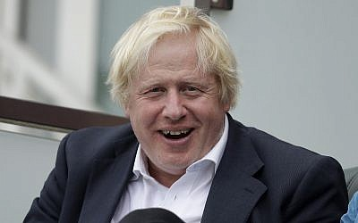 In this photo from September 8, 2018, Britain's former foreign secretary Boris Johnson reacts to seeing photographers taking his picture as he sits in a spectator seat whilst attending the fifth cricket test match of a five match series between England and India at the Oval cricket ground in London. (AP Photo/Matt Dunham, File)
