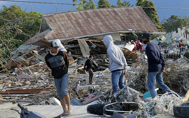 People survey the damage to a residential area following a massive earthquake and tsunami at Talise beach in Palu, Central Sulawesi, Indonesia, Oct. 1, 2018 (AP Photo/Tatan Syuflana)