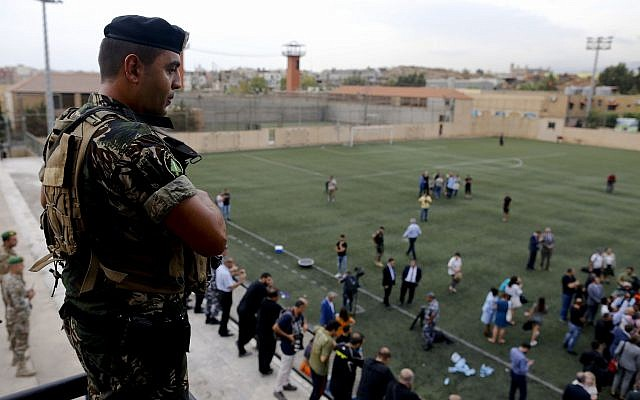 A Lebanese soldier stands guard as Lebanese Foreign Minister Gebran Bassil tours a soccer club, with diplomats and journalists, one of several locations they visited near Beirut's international airport, in Beirut, Lebanon, Monday, Oct. 1, 2018. (AP /Hassan Ammar)