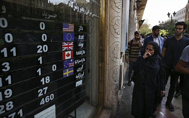 An exchange shop displays rates for various currencies, in downtown Tehran, Iran, October 2, 2018. (AP Photo/Vahid Salemi)