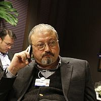 In this January 29, 2011, photo, Saudi Arabian journalist Jamal Khashoggi speaks on his cellphone at the World Economic Forum in Davos, Switzerland. (AP Photo/Virginia Mayo)