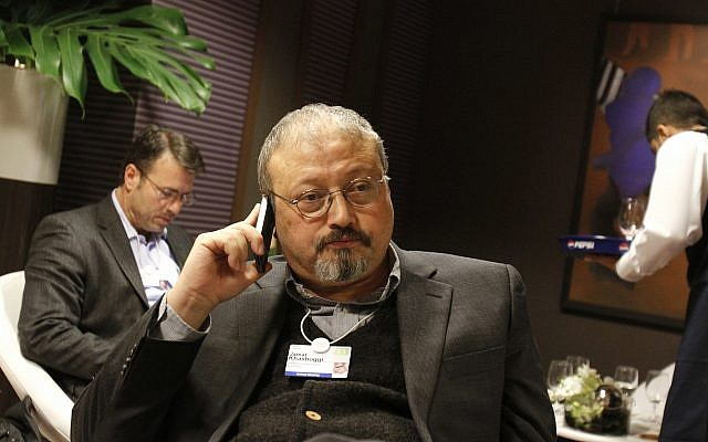 Saudi Arabian journalist Jamal Khashoggi speaks on his cellphone at the World Economic Forum in Davos, Switzerland, January 29, 2011. (AP Photo/Virginia Mayo)