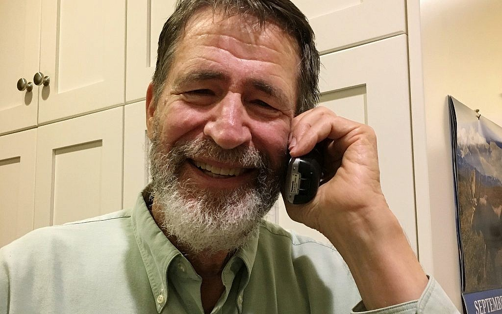 George P. Smith talks on the phone with The Associated Press at his home in Columbia, Missouri, United States, October 3, 2018, after learning he had won the 2018 Nobel Prize in Chemistry. (Marjorie Sable via AP)