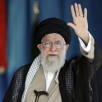 Supreme Leader Ayatollah Ali Khamenei waves to thousands of members of the Basij paramilitary organization in their gathering at the Azadi stadium in Tehran, Iran, on October 4, 2018. (Office of the Iranian Supreme Leader via AP)