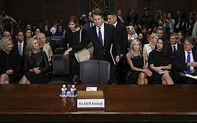 In this Sept. 27, 2018 file photo, Supreme Court nominee Brett Kavanaugh arrives to testify before the Senate Judiciary Committee on Capitol Hill in Washington. Seated second row, second from left, Joel Kaplan, Facebook's vice president for global public policy. (Win McNamee/Pool Photo via AP)