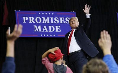 US President Donald Trump waves to supporters after speaking at a campaign rally at Kansas Expocentre, October 6, 2018, in Topeka, Kansas. (AP Photo/Pablo Martinez Monsivais)