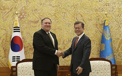 South Korean President Moon Jae-in, right, shakes hands with US Secretary of State Mike Pompeo during a meeting at the presidential Blue House in Seoul, South Korea, October 7, 2018. (AP Photo/Ahn Young-joon. Pool)