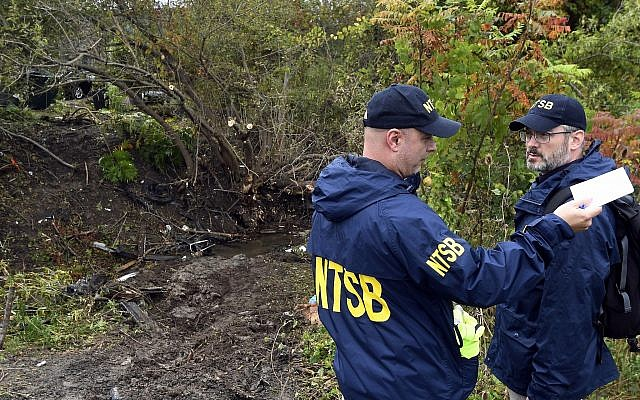 Debris scatters an area Sunday, Oct. 7, 2018, at the site of the fatal crash Schoharie, N.Y. (AP Photo/Hans Pennink)
