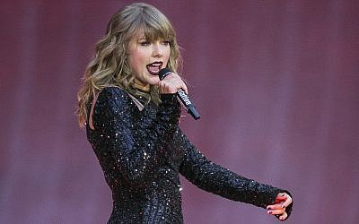 In this June 22, 2018, file photo, singer Taylor Swift performs on stage in concert at Wembley Stadium in London. (Photo by Joel C Ryan/Invision/AP, File)