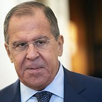 Russian Foreign Minister Sergey Lavrov enters a hall during his meeting with Italian Foreign Minister Enzo Moavero in Moscow, Russia, Monday, October 8, 2018 (AP Photo/Pavel Golovkin)