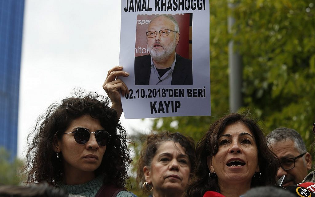 Activists, members of the Human Rights Association Istanbul branch, holding posters with photos of missing Saudi journalist Jamal Khashoggi, talk to members of the media, during a protest in his support near the Saudi Arabia consulate in Istanbul, October 9, 2018. (AP Photo/Lefteris Pitarakis)