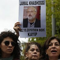 Activists and members of the Human Rights Association Istanbul branch hold posters with photos of missing Saudi journalist Jamal Khashoggi and talk to members of the media, during a protest in his support near the Saudi Arabia consulate in Istanbul, October 9, 2018. AP Photo/Lefteris Pitarakis)