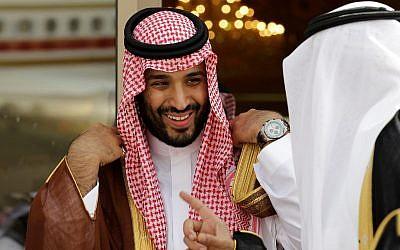 In this May 14, 2012 photo, Prince Mohammed bin Salman speaks with a Saudi prince in Riyadh, Saudi Arabia. (AP Photo/Hassan Ammar)