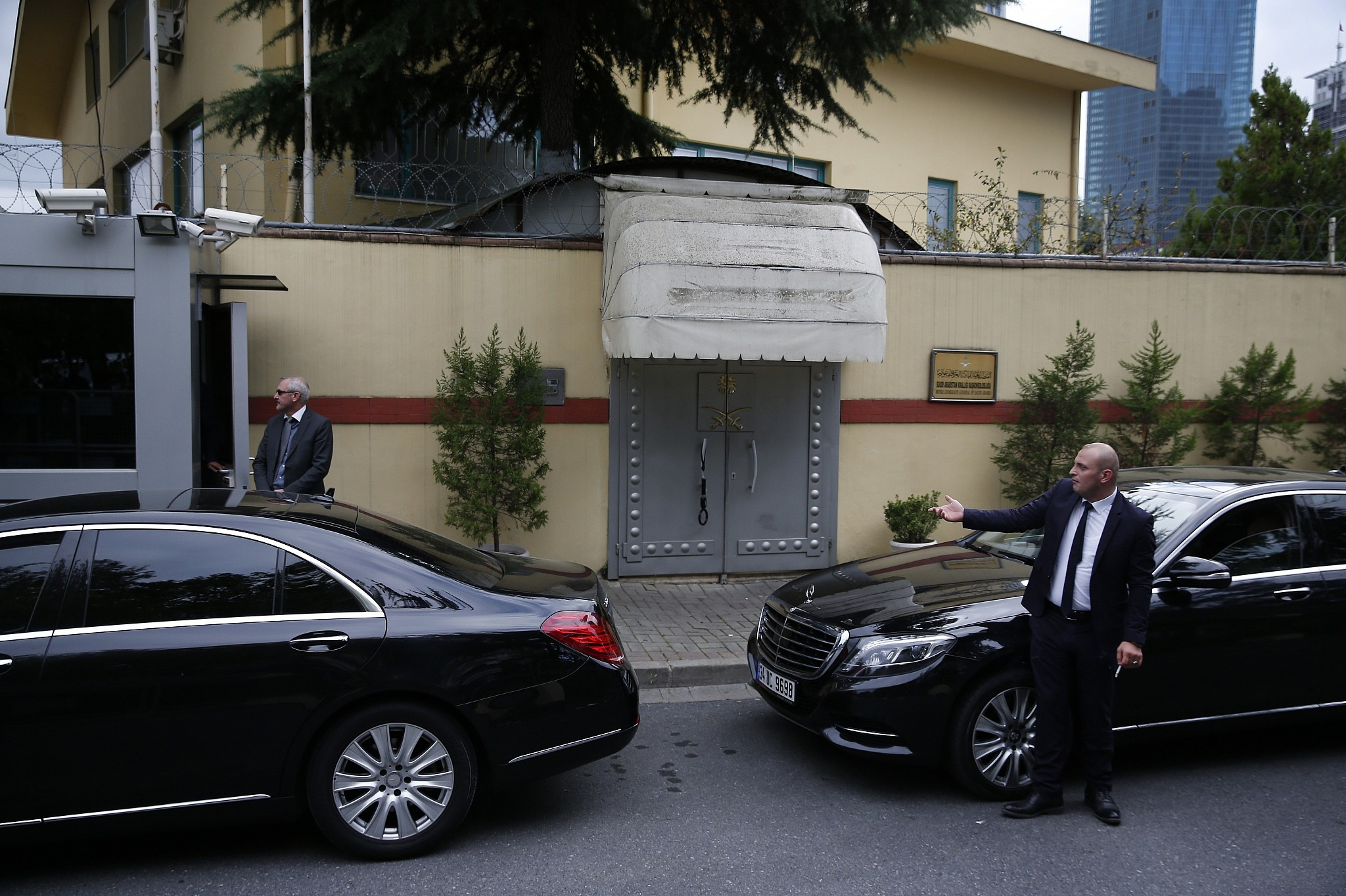 Security guards stand outside the Saudi Arabia's consulate in Istanbul