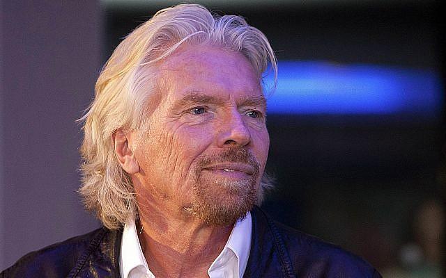 British billionaire Richard Branson visits a Zumba Step dance class at Virgin installations in Madrid, Spain, December 10, 2003. (AP Photo/Abraham Caro Marin, file)
