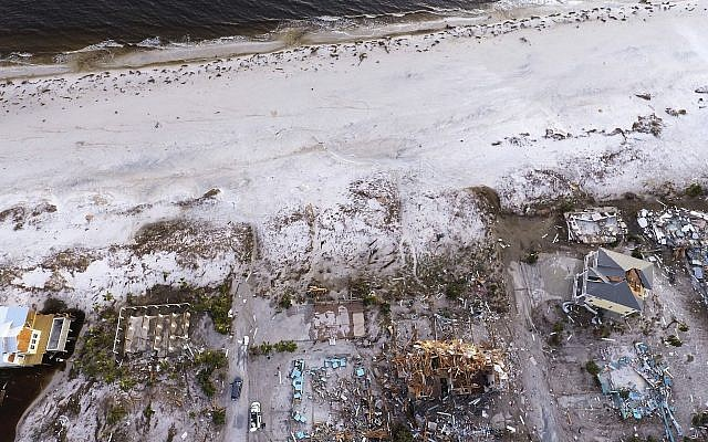 Damaged homes are seen along the water's edge in the aftermath of hurricane Michael in Mexico Beach, Florida., Friday, October 12, 2018. (AP Photo/David Goldman)