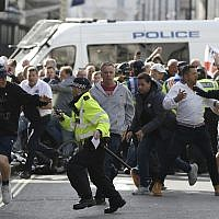 Police stop a breakaway from the main Football Lads alliance march, as they attempt to get close to a rival anti-fascist demonstration in London, Saturday, October 13, 2018 (AP Photo/Alastair Grant)