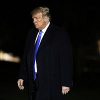 President Donald Trump crosses the South Lawn on his return to the White House, Saturday Oct. 13, 2018, in Washington, after a trip to Kentucky. (AP Photo/Jacquelyn Martin)