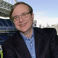 In this July 17, 2001 file photo, Seattle Seahawks owner Paul Allen appears in a suite in the team's stadium in Seattle. Allen, billionaire owner of the Trail Blazers and the Seattle Seahawks and Microsoft co-founder, died Monday, Oct. 15, 2018 at age 65. Earlier this month Allen said the cancer he was treated for in 2009, non-Hodgkin's lymphoma, had returned.  (AP Photo/Elaine Thompson, File)