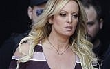 """In this Thursday, Oct. 11, 2018, file photo, adult film actress Stormy Daniels arrives for the opening of the adult entertainment fair """"Venus,"""" in Berlin. On Monday, Oct. 15, 2018, a federal judge dismissed Daniels' defamation lawsuit against President Donald Trump. (AP Photo/Markus Schreiber, File)"""