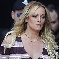 "In this Thursday, Oct. 11, 2018, file photo, adult film actress Stormy Daniels arrives for the opening of the adult entertainment fair ""Venus,"" in Berlin. On Monday, Oct. 15, 2018, a federal judge dismissed Daniels' defamation lawsuit against President Donald Trump. (AP Photo/Markus Schreiber, File)"