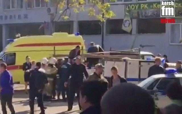 This image made from video shows the scene as emergency services load an injured person onto a truck, in Kerch, Crimea, Wednesday Oct. 17, 2018. (Kerch FM News via AP)
