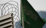 Behind barbed wire, Saudi Arabia's flag flies atop the country's consulate in Istanbul, October 18, 2018 (AP Photo/Lefteris Pitarakis)
