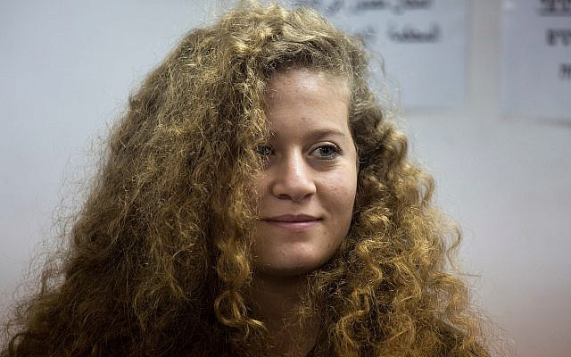 In this Tuesday, February 13, 2018 file photo, Palestinian activist Ahed Tamimi stands inside the Ofer military prison near Jerusalem. (AP Photo/Ariel Schalit, File)