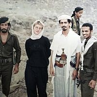 This 1994 photo provided by Katherine Roth shows her standing with Yemeni fighters. The photo was taken by Jamal Khashoggi in Yemen after the country's civil war. Khashoggi was Roth's friend and mentor when she was a young reporter on a fellowship studying Islamic movements. (Jamal Khashoggi/Courtesy of Katherine Roth via AP)