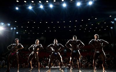 Contestants participate in the final round during the National Amateur Body Builders' Association competition in Tel Aviv, Israel, October 18, 2018. (Oded Balilty/AP)