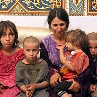 This photo released by the Syrian official news agency SANA on October 20, 2018, shows Abeer Shalgheen and her four children after being freed by the Islamic State jihadist group that kidnapped them on July 25 during a raid by the extremists on the southern province of Sweida, Syria. (SANA via AP)