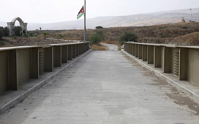 A Jordanian flag hangs on a pool on a bridge leading from Israel to Jordan in the Jordan valley area called Naharayim, or Baqura in Arabic, in northern Israel, Monday, Oct. 22, 2018 (AP Photo/Ariel Schalit)