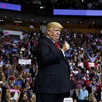 US President Donald Trump arrives for a campaign rally for Senator Ted Cruz at the Houston Toyota Center on October 22, 2018, in Houston, Texas. (AP Photo/Evan Vucci)
