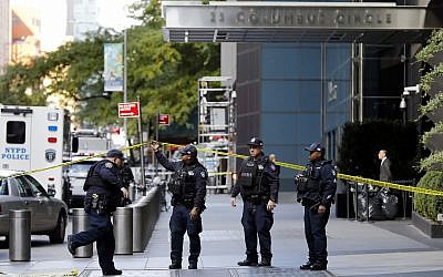New York City Police Dept. officers arrive outside the Time Warner Center, in New York on October 24, 2018. (AP Photo/Richard Drew)