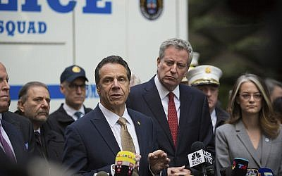 New York City Mayor Bill de Blasio looks on as Gov. Andrew Cuomo delivers remarks during a news conference after NYPD personnel removed an explosive device from Time Warner Center, October 24, 2018, in New York. (AP Photo/Kevin Hagen).