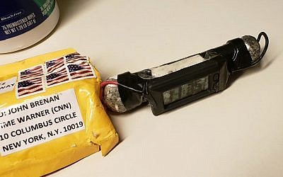 This image obtained October. 24, 2018, and provided by ABC News shows a package addressed to former CIA head John Brennan and an explosive device that was sent to CNN's New York office. (ABC News via AP)