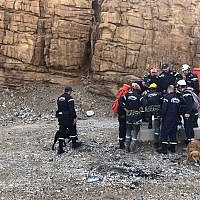 Illustrative: Jordanian rescuers with sniffer dogs search for survivors of flash floods at the Dead Sea area, Jordan, on October 26, 2018. (AP Photo/Omar Akour)