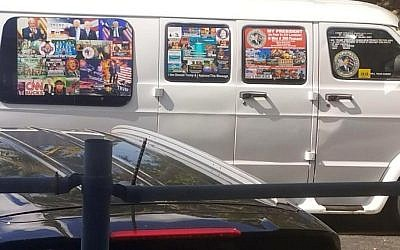 This November 1, 2017, photo shows a van with windows covered with an assortment of stickers in Well, Florida, that apparently was owned by Cesar Sayoc. (Courtesy Lesley Abravanel via AP)