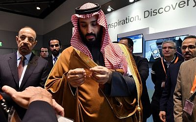 Saudi Arabia Crown Prince Mohammed bin Salman tours an innovation gallery of Saudi Arabian technology, including an exhibit by King Abdullah University of Science and Technology, during a visit to Massachusetts Institute of Technology in Cambridge, Mass., March 24, 2018. (Josh Reynolds/AP Images for KAUST)